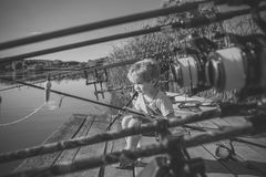Child Childhood Children Happiness Concept. Summer vacation of little boy fishing. On river Royalty Free Stock Photos