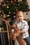 Child and Chirstmas Tree Stock Photos