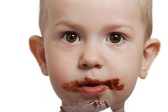 Child with chocolate Stock Photos