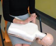 Child choking back blow procedure Stock Photos