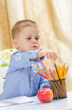 Child choose between colored pencil Stock Image