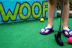 Child chooses best ball at miniature golf Stock Photography