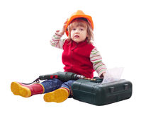 Child  chooses tools in toolbox Royalty Free Stock Image