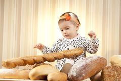 Child choosing baguette Royalty Free Stock Images