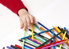 Child choosing crayon, many colorful pencils Stock Photos