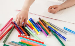 Child choosing a soft-tip pen Stock Image