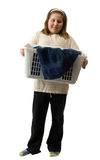 Child Chores. Full body view of a young girl holding a basket of soiled laundry, isolated against a white background Royalty Free Stock Photography