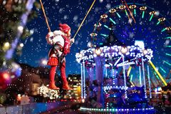 Child at Christmas fair. Kids bungee jumping. Royalty Free Stock Photography