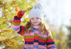 Child and christmas ball outdoors in winter Stock Photography