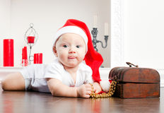 Child In Christmas Cap Stock Photos