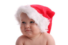 Child in a Christmas cap looking aside Royalty Free Stock Image