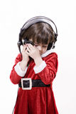 Child with Christmas costume and cell phone Royalty Free Stock Photography