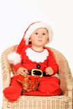 Child in christmas dress Royalty Free Stock Photos