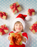 Child with Christmas gif boxes Royalty Free Stock Photo