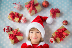 Child with Christmas gift boxes Royalty Free Stock Photography