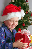 Child and christmas gifts Royalty Free Stock Image