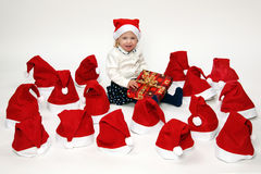 Child with christmas gifts. Blond girl with christmas presents Royalty Free Stock Photos