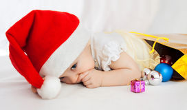 Child in christmas hat Stock Images