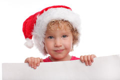 Child in a Christmas hat with blank Stock Image