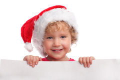 Child in a Christmas hat with blank Royalty Free Stock Image