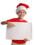 Child in a Christmas hat and the form in hands Royalty Free Stock Photo