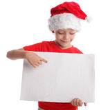 Child in a Christmas hat and the form in hands Stock Photos
