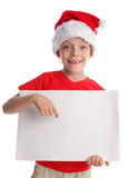 Child in a Christmas hat and the form in hands Royalty Free Stock Photography