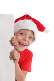 Child in a Christmas hat and the form in hands Royalty Free Stock Images