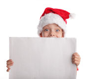 Child in a Christmas hat and the form in hands Stock Images