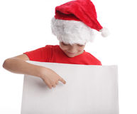 Child in a Christmas hat and the form in hands Stock Photo