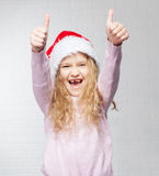 Child in christmas hat. On white background. Happy little girl Stock Photography