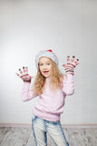 Child in christmas hat. On white background. Happy little girl Royalty Free Stock Images