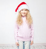 Child in christmas hat. On white background. Happy little girl Stock Photo