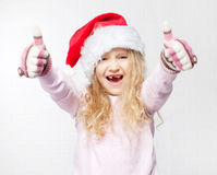 Child in christmas hat. On white background. Happy little girl Stock Images