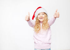 Child in christmas hat. On white background. Happy little girl Royalty Free Stock Photo
