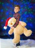 Child and Christmas lights Stock Image