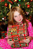 Child with Christmas present Stock Images