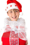 Child with Christmas present Stock Photos
