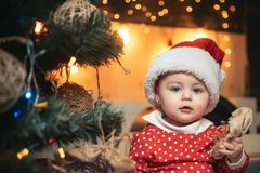 Child with a Christmas present gift. Cute little kids celebrating Christmas. Babies. Happy child with christmas gift. stock photography