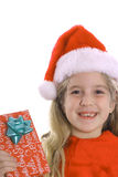 Child christmas present hat. Shot of a child with christmas present & hat Royalty Free Stock Photography