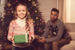 Child with christmas present Royalty Free Stock Photography