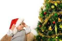 Child and christmas tree Stock Photo