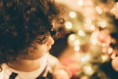 Child and Christmas tree lights Royalty Free Stock Image