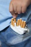 Child and cigarette stock photo