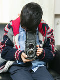 Child with classic camera Royalty Free Stock Photo