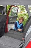 Child cleaning car interior Royalty Free Stock Image