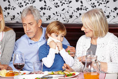 Child cleaning mouth with napkin Stock Photos