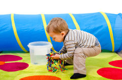 Child cleaning up Stock Photo