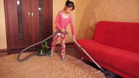 The child cleans apartment. stock video
