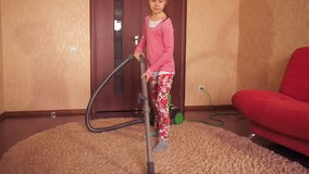 The child cleans apartment. stock footage